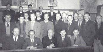 Bansha Rural Committee, 1948. Back row (L-R): [unknown]; Fr Walsh; Willie Matt Grogan; Charlie O'Neill; and Dan O'Connell. Second row from back (L-R): John Butler; Fr English; [unknown]; Tom Brosnan; and Ned Haney. Second row from front (L-R): Paddy Gallagher; Alfred Kissane; Dr Jim Russell; [unknown]; [unknown]; [unknown]; [unknown]; and [unknown]. Front row (L-R): [unknown]; [unknown]; Canon Hayes; [unknown]; and [unknown].